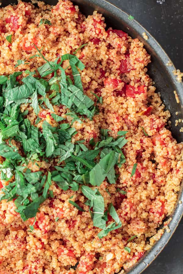 Cooked quinoa added to the cooked tomatoes