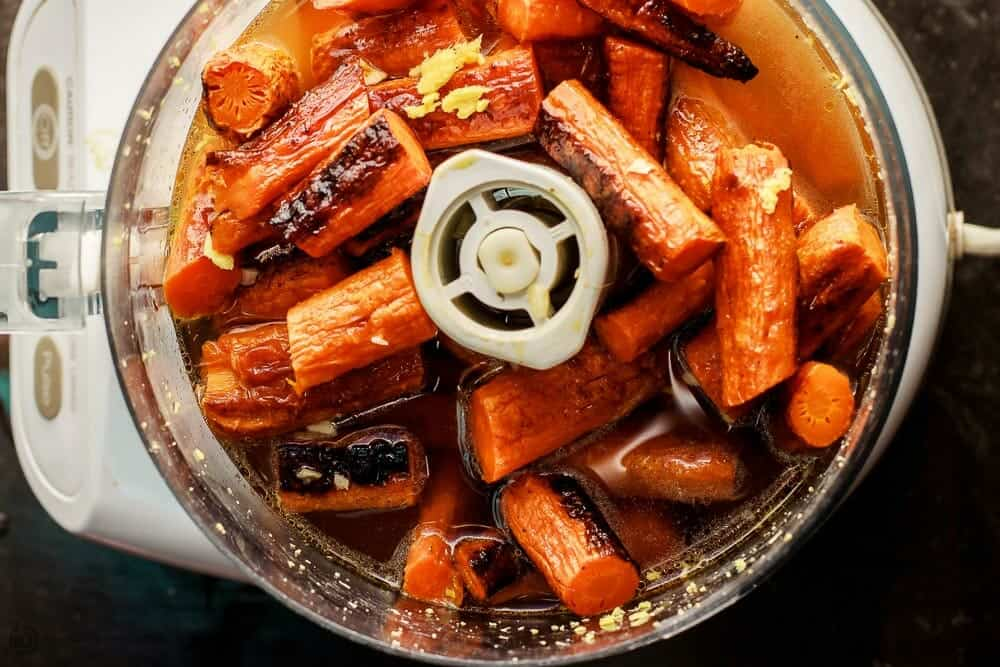 Add roasted carrots with broth, ginger and garlic in food processor
