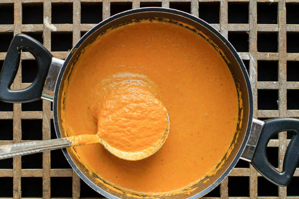 Final step for roasted carrot soup. Stir in fat free half and half and warm through
