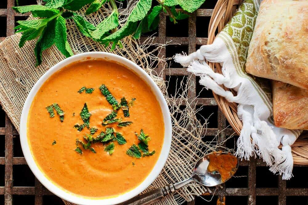 Roasted Carrot Soup with a garnish of fresh mint