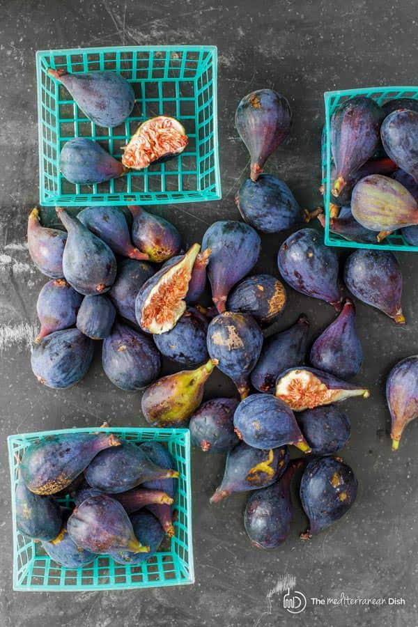 Purple Figs spread out on a table