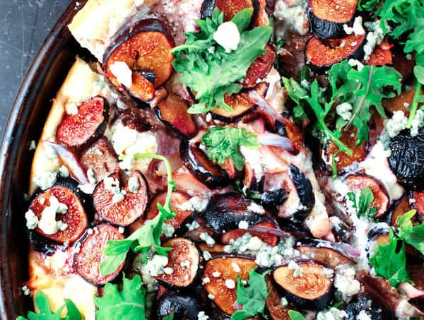 Homemade Pizza with Three Cheeses, Steak and Figs | The Mediterranean Dish. Ditch take-out and try this easy homemade pizza with steak, figs, kale and three different cheeses! It's homemade pizza like you would eat at Mediterranean pizzeria! Step-by-step photos included.