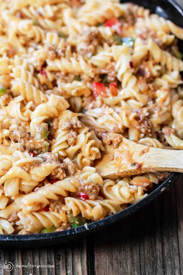 One-Skillet Macaroni and Cheese with Italian Sausage and Bell Peppers | The Mediterranean Dish. Try this delicious Italian twist on macaroni and cheese! The perfect comfort skillet meal; comes together in minutes!