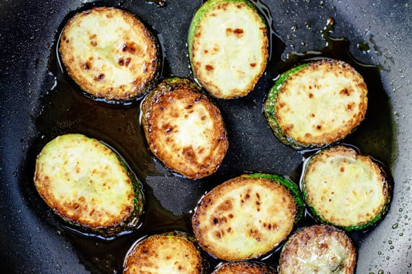 Zucchini rounds fried in a pan