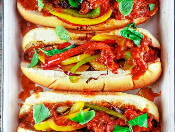 Easy Italian Sausage and Peppers Hoagies | The Mediterranean Dish. These classic Italian-American sandwiches are packed with flavor and super easy to prepare! With an added juiciness from the Tuscan-inspiredBertolli® Tomato & Basil Pasta Sauce. Take your game day or party to the next level!