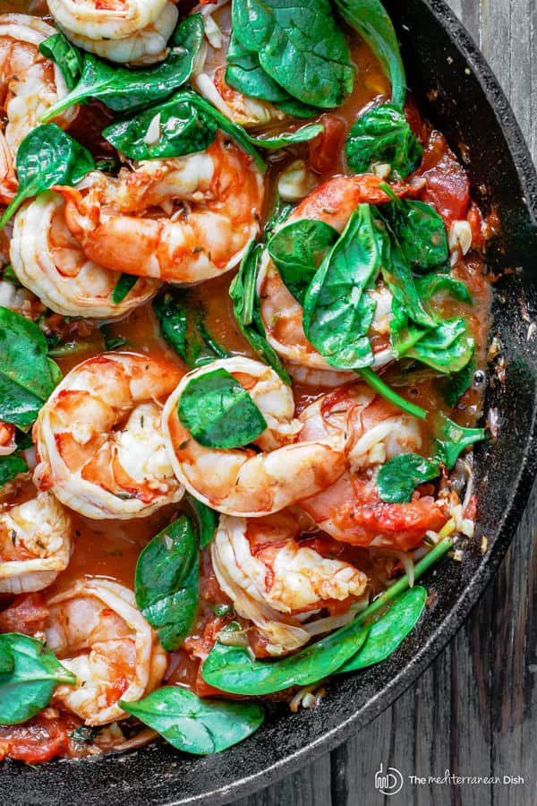 Shrimp with orzo garnished with fresh spinach