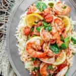 Garlic-Shrimp Orzo Recipe | The Mediterranean Dish. This easy Mediterranean shrimp recipe is the perfect weeknight meal. A few ingredients like white wine, lemon juice, garlic and tomatoes make a special flavor-packed sauce for the prawns or shrimp. Add a simple orzo or pasta of your choice and voila!