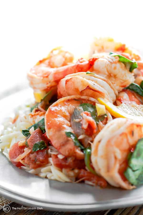 Final product - garlic shrimp with orzo garnished with fresh spinach
