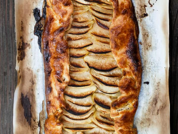 Simple Apple Galette Recipe | The Mediterranean Dish. A must make! Even if you are not a baker, you can still make this galette with the step-by-step tutorial! The rum syrup takes this cozy, flaky pastry to a new level of decadent. I will definitely make this apple galette again.