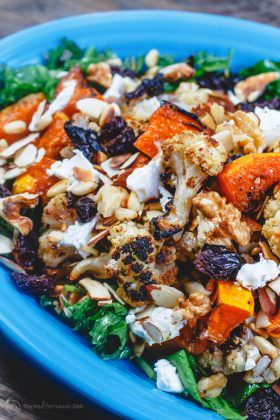 Roasted Butternut Squash and Cauliflower Salad | The Mediterranean Dish. An easy, comforting and bright salad! Try it for lunch or add it to your dinner or even to the Thanksgiving feast!