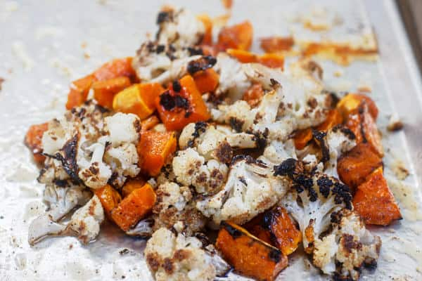 Pile of Roasted Butternut Squash and Cauliflower on a baking sheet