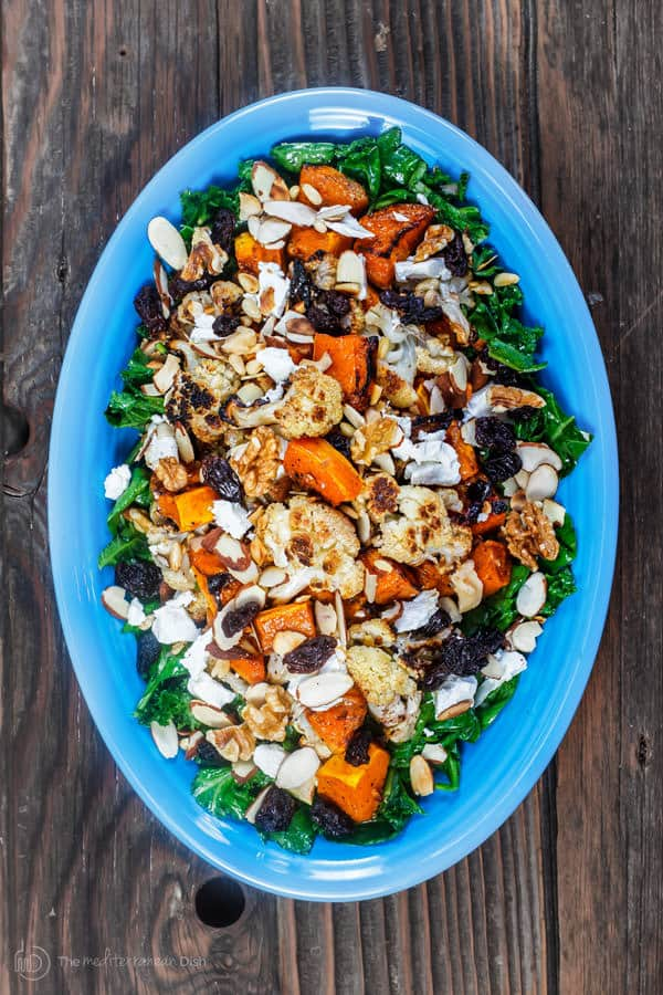Plate of Cauliflower and Butternut Squash salad garnished with nuts and goat cheese
