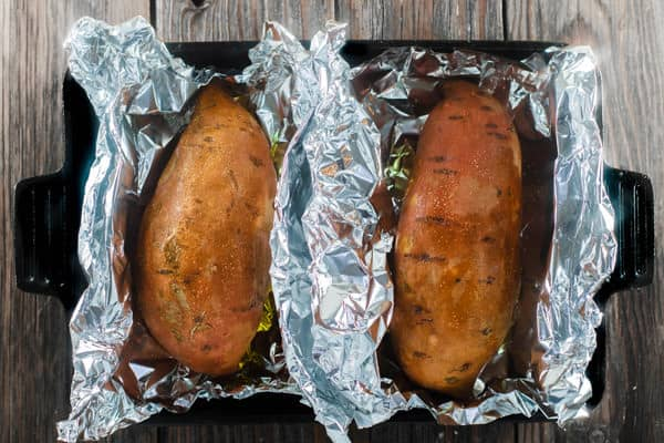 Sweet Potatoes in a baking pan in aluminum foil