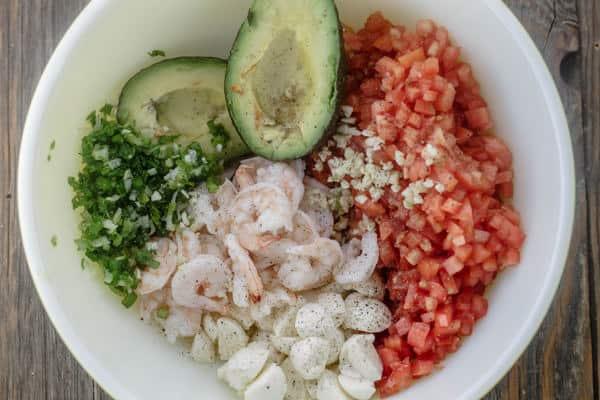 Ingredients for Shrimp Bruschetta arranged in a bowl before mixing