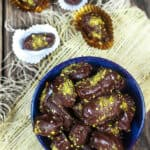 Chocolate Covered Date Recipe | The Mediterranean Dish. Melt-in-your-mouth soft medjool dates, stuffed with almonds and covered in chocolate! An easy make-ahead gluten free (and vegan) dessert. These homemade candy make the perfect edible gift!