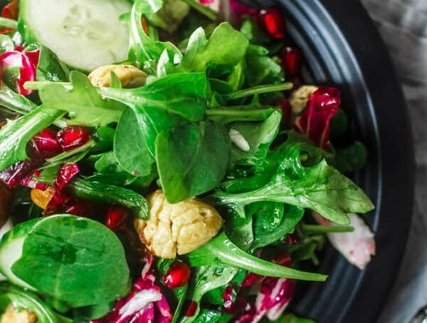 Spinach Arugula Salad with Chestnuts and Pomegranates | The Mediterranean Dish. This spinach arugula salad with chestnuts and pomegranates is a simple, nutrition-packed and festive salad for a special dinner! With a light white wine vinaigrette!