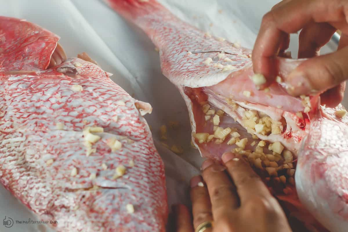 Snapper is filled with minced garlic