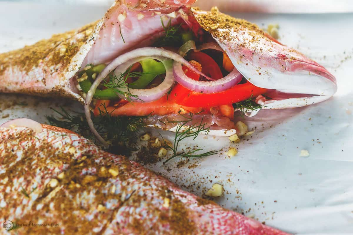 Snapper is stuffed with onion and pepper