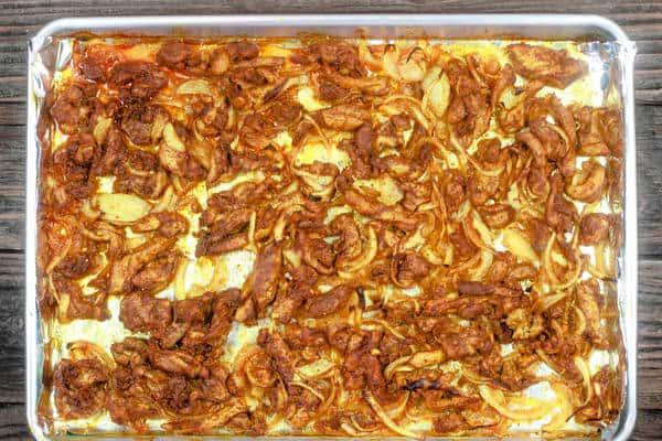 Baked chicken shawarma on baking sheet