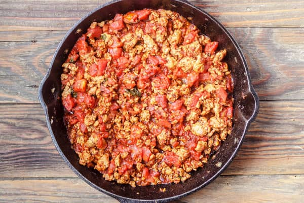 Italian Sausage with canned tomatoes in a skillet