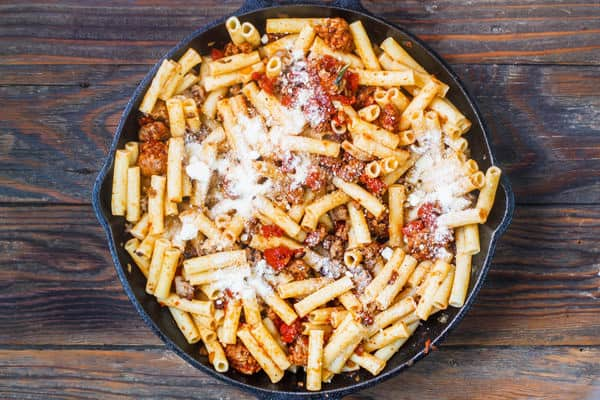 Ziti added to skillet of sausage and tomato sauce
