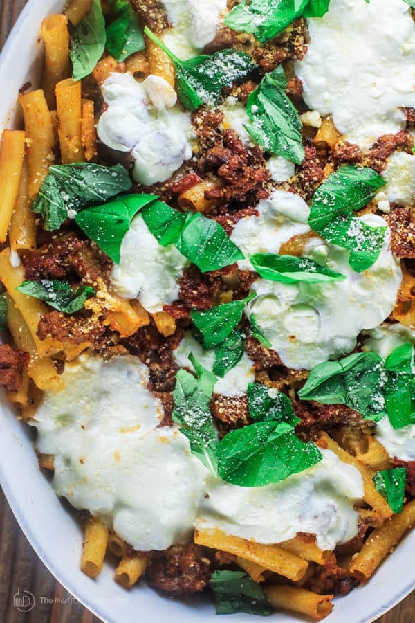 Baked Ziti served in a platter with Italian Sausage and Fresh Mozzarella