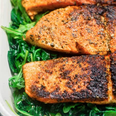 Pan Seared Salmon Recipe with Orange Juice, Wilted Spinach and Arugula| The Mediterranean Dish. It takes less than 15 minutes to prepare this elegant, no-fuss dinner. Season the salmon; sear in olive oil, and add a splash of orange juice. See the step-by-step from @themediterraneandish.