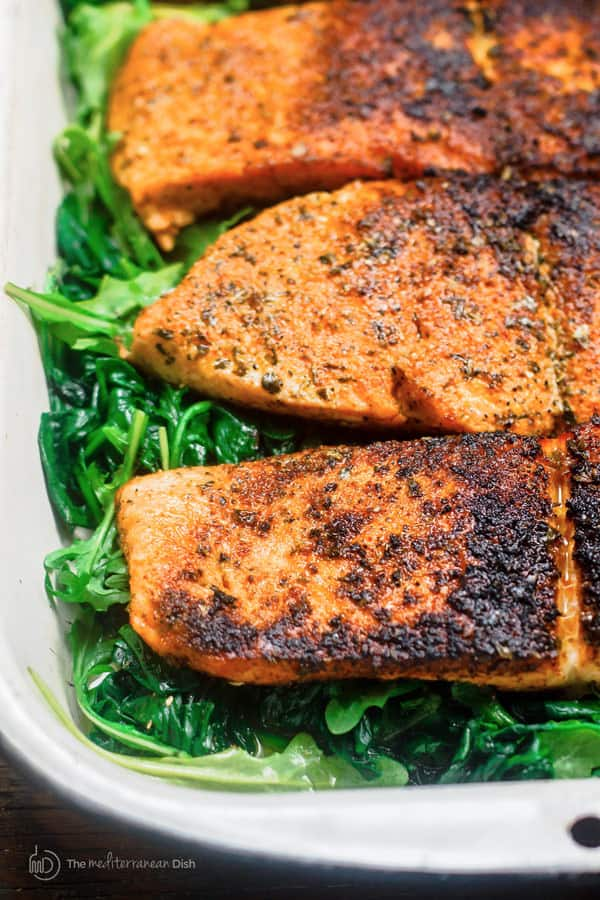 Cooked Salmon on a bed of greens