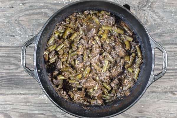 Beef stew with vegetables and spices in pot after cooking on stove top