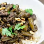 Middle Eastern Beef Stew Recipe with Green Beans   The Mediterranean Dish. Tender beef stew cooked with green beans and tomatoes with warm spices like coriander, cinnamon and allspice. Step-by-step photos included with the recipe. Click the pin to follow!