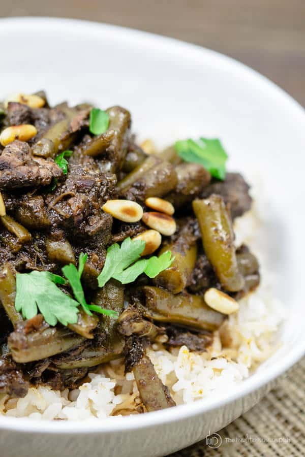 Mediterranean Beef Stew garnished with pine nuts and parsley