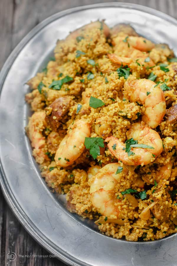 A plated serving of spicy chorizo and shrimp with couscous