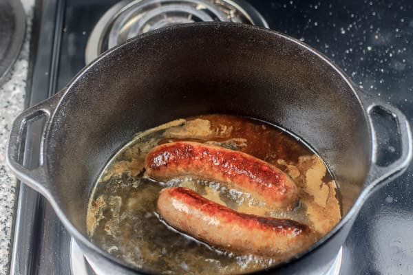 Sausages being cooked in a pot