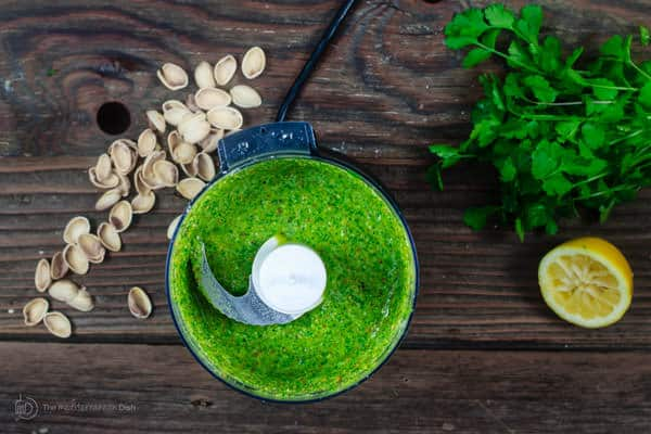 Ingredients for Pistachio Cilantro Pesto combined in a food processor