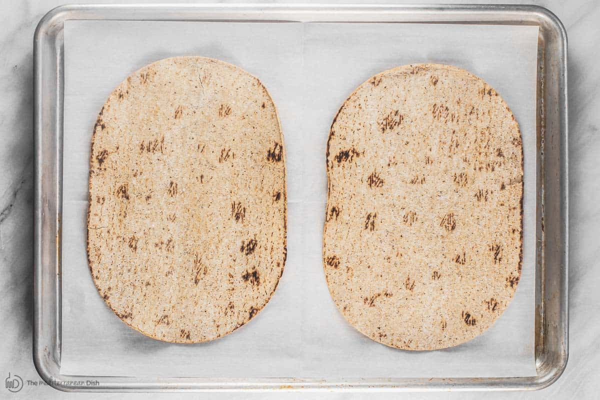 Flatbread on baking sheet lined with parchment paper