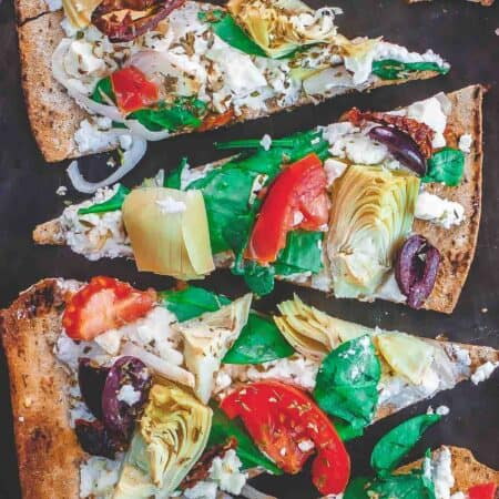 Flatbread pizza with garden vegetables and feta cheese