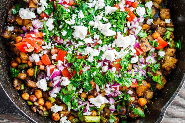 Mediterranean Potato Hash garnished with feta cheese and parsley