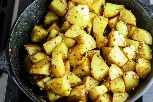 Potatoes now added to the lemony spice mixture