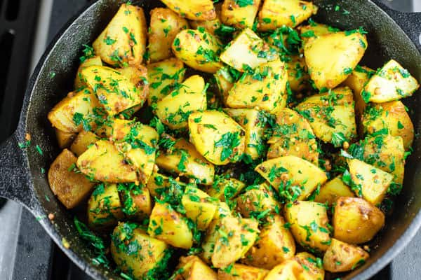 Spicy potatoes now coated with fresh herbs like cilantro, dill and parsley