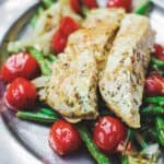 One Pan Baked Halibut Recipe   The Mediterranean Dish. Halibut fillet with green beans and cherry tomatoes baked in a delicious Mediterranean sauce with garlic, olive oil and lemon juice. Comes together in less than 30 mins! See the step-by-step on The Mediterranean Dish.