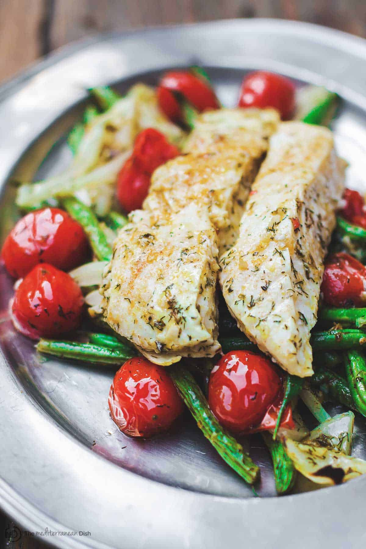 Baked Halibut Served with Cherry Tomatoes, Green Beans and Onions