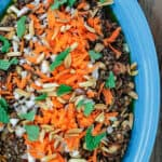Harissa Lentil Salad Recipe | The Mediterranean Dish. A spicy lentil salad with white beans, tomatoes, Middle Eastern spices and harissa paste. A flavor-packed salad or side dish! Comes together in mins. See this recipe and more on TheMediterraneanDish.com