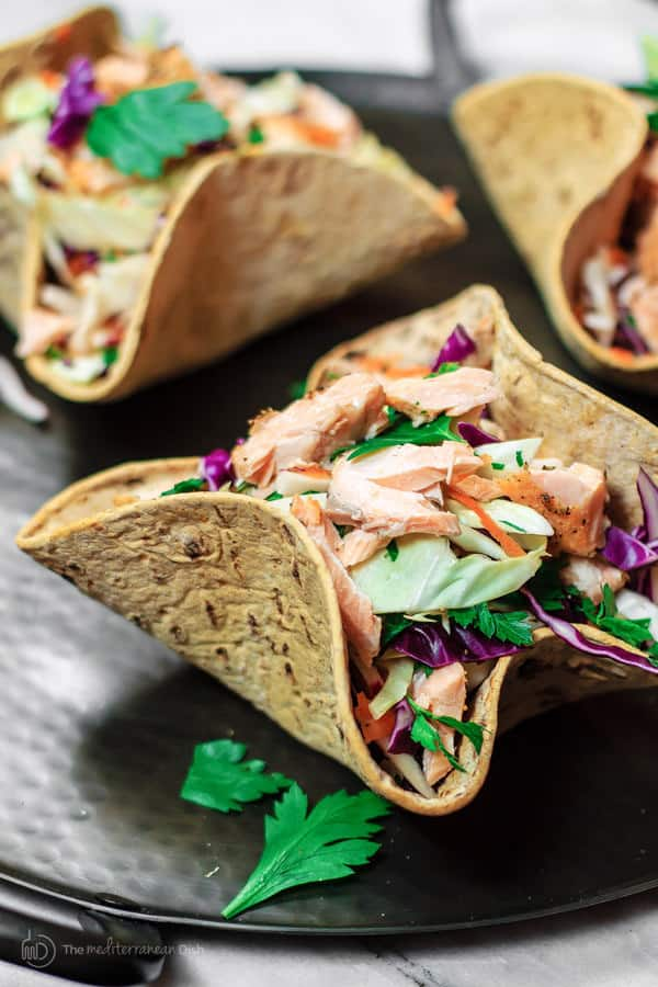 Close-up of Mediterranean Coleslaw and Salmon Bowls using Flatout Wraps