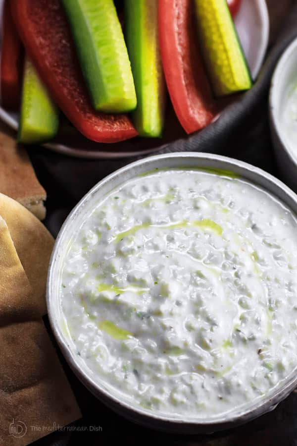 Authentic Tzatziki Sauce Recipe | The Mediterranean Dish. The best tzatziki sauce recipe with Greek yogurt, cucumbers and garlic. From the Greek island of Paros! This is an authentic, creamy and inteseley flavored tzatziki recipe. Comes with step-by-step photos. Click on the pin image to see it and browse TheMediterraneanDish.com for more Mediterranean recipes!