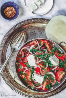 Mediterranean Tomato salad with onions, fresh herbs and feta. Served with pita bread