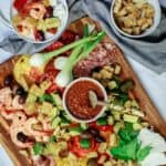 Shrimp and Zucchini Panzanella Salad Recipe | The Mediterranean Dish. An all-star Italian Panzenalla Salad with heirloom tomatoes, shrimp, roasted zucchini and more! A thick garlicy sun-dried tomato dressing served on the side! The perfect appetizer for a crowd! See more at TheMediterraneanDish.com