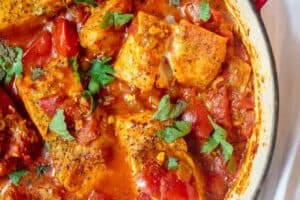 Fish fillet cooked with tomato sauce and served shakshuka style in a braiser