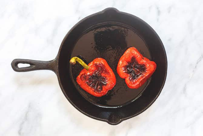 Bell peppers in a skillet brushed with olive oil