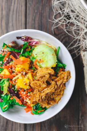 Spinach Quinoa Mango Salad Recipe with Chicken | The Mediterranean Dish. A power mango salad with spinach, arugula, radicchio, quinoa, and BBQ pulled chicken with a zesty lemon-ginger vinaigrette. A great Mediterranean salad with a Southern twist! See it on TheMediterraneanDish.com