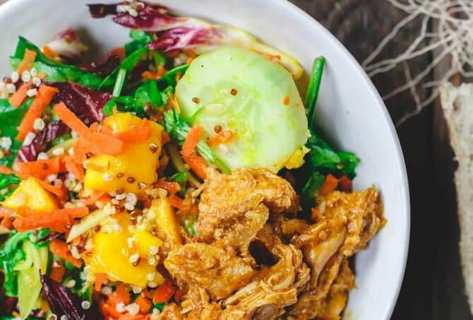 Spinach Quinoa Mango Salad Recipe with Chicken   The Mediterranean Dish. A power mango salad with spinach, arugula, radicchio, quinoa, and BBQ pulled chicken with a zesty lemon-ginger vinaigrette. A great Mediterranean salad with a Southern twist! See it on TheMediterraneanDish.com